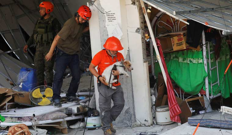 Philippines earthquake: 11 dead, dozens feared buried under building