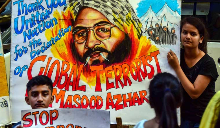 Students hold up posters as Jaish-e-Mohammad head Masood Azhar was blacklisted by UN Security Council committee, in Mumbai | PTI