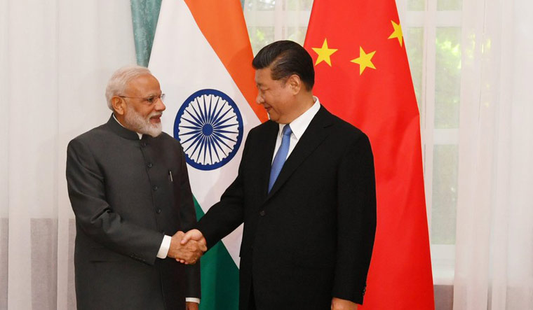 Prime Minister Narendra Modi meeting with the Chinese President Xi Jinping on the sidelines of the SCO Summit in Bishkek | Twitter/PIB
