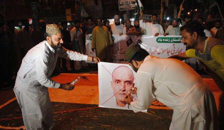 Jadhav protest Pak AP