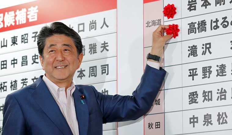 Shinzo Abe on course to retain majority in upper house election