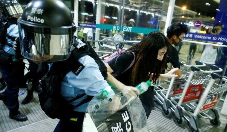 Riot-police-pepper-spray-HKIA-Reuters