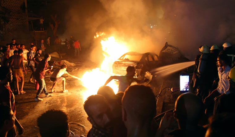 19 killed after car crash in Cairo sets off fire at hospital