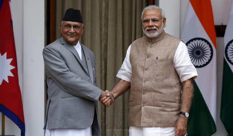 [File] Nepal's Prime Minister Khadga Prasad Sharma Oli (L) shakes hands with his Indian counterpart Narendra Modi during a photo opportunity ahead of their meeting at Hyderabad House in New Delhi, India, February 20, 2016 | Reuters