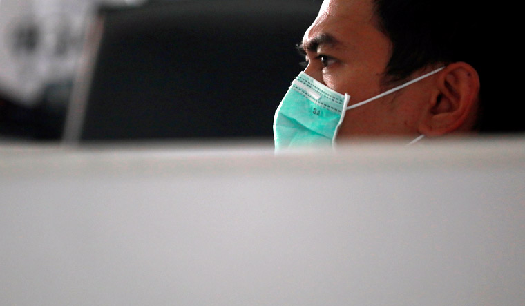 health-official-mask-disease-death-toll-virus-outbreak-Reuters