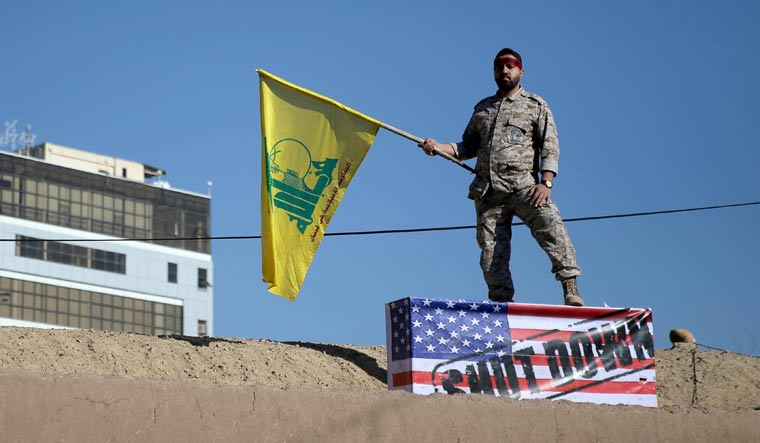 Iran-fighter-Hezbollah-Flag-Reuters