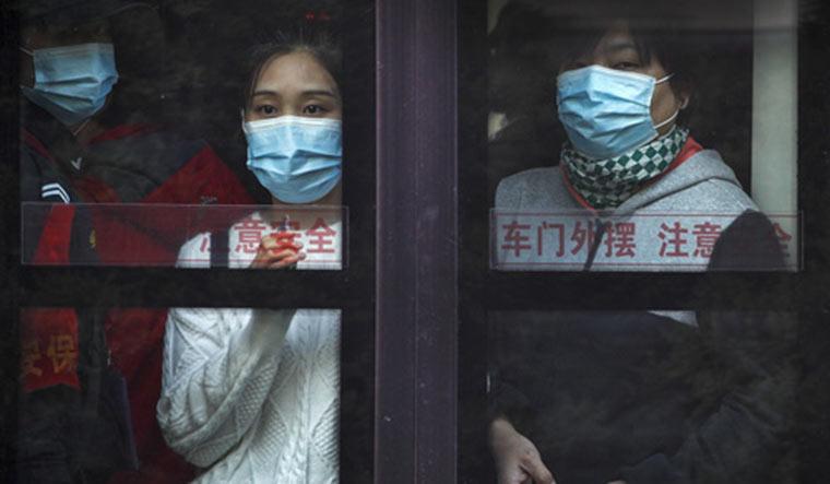 Beijing-mask-covid-AP