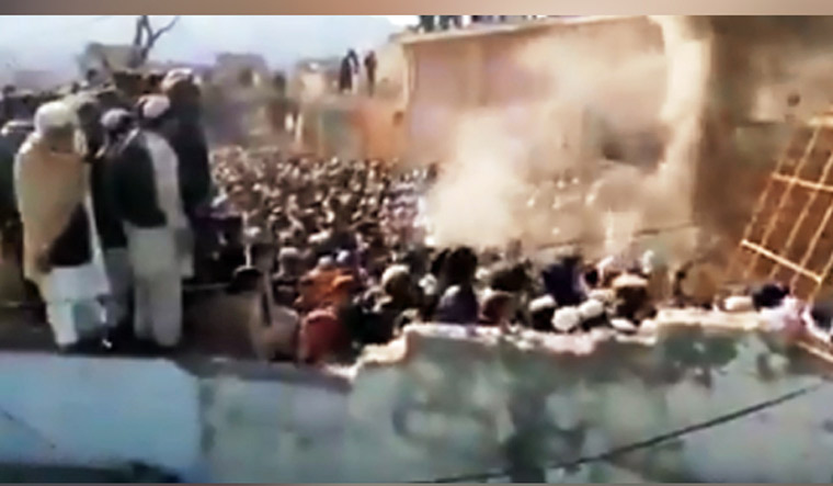 A Hindu temple was destroyed and set on fire by mob in Pakistan's Khyber Pakhtunkhwa province   ANI/Twitter