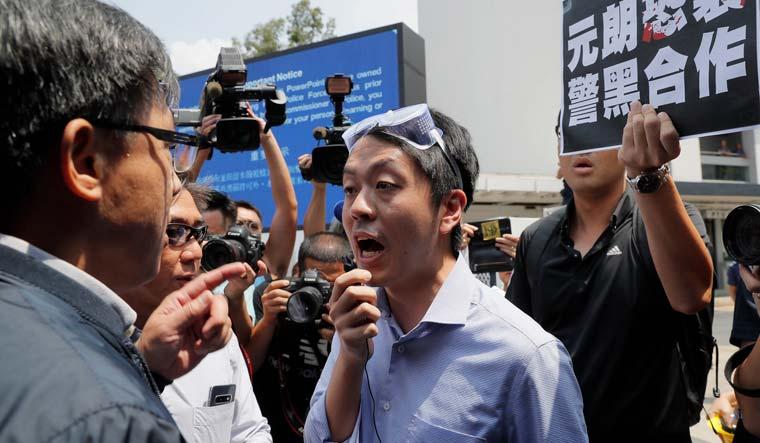 Former Hong Kong legislator says accounts were frozen after he sought exile