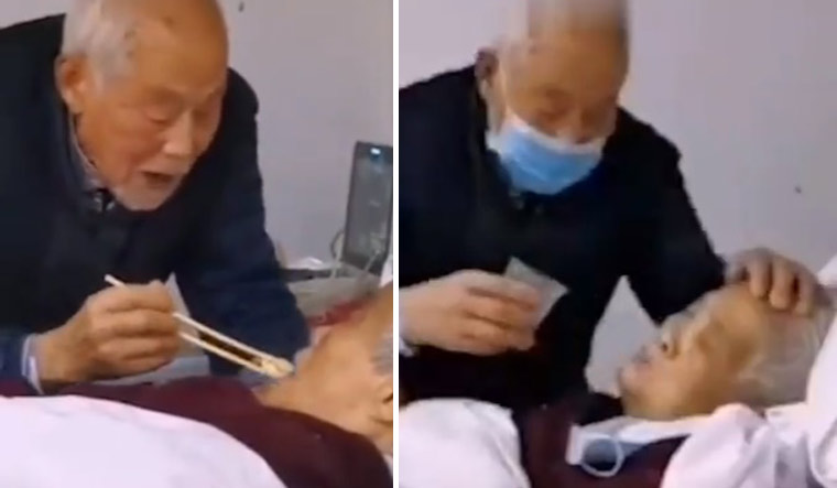 WATCH: 87-year-old man feeding wife infected with coronavirus moves netizens