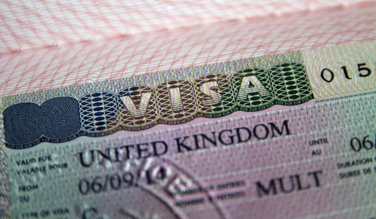 What is the new points-based visa system introduced by UK minister Priti Patel?