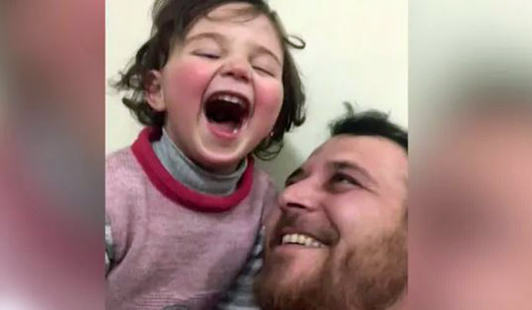 Syrian father devises game so that daughter learns to drown sound of bombs
