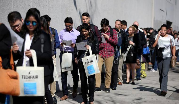 [File] People wait in line to attend TechFair LA, a technology job fair, in Los Angeles | Reuters