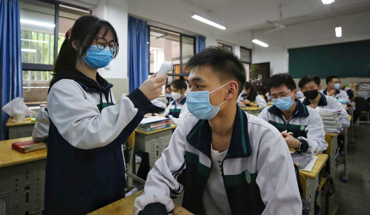 Chinese researchers debunk theory that COVID-19 originated from Wuhan wet market