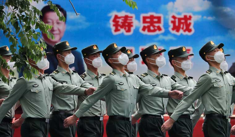 Xi-JinPing-PLA-soldiers-march-AP