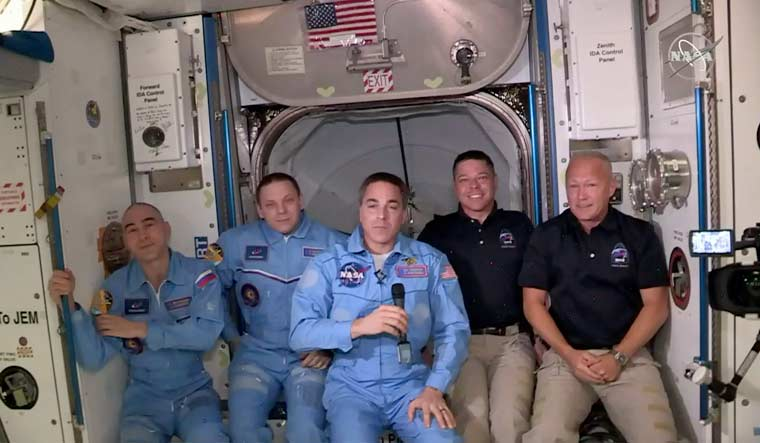 SpaceX's Dragon spacecraft docks at ISS, astronauts board space station