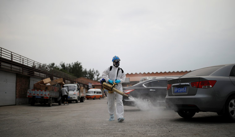 healthcare-worker-spraying-Beijing-COVID19-sanitising-Reuters