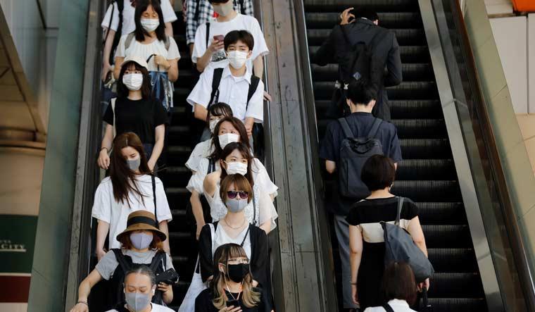 japan-tokyo-escalator-masks-covid-19-reuters