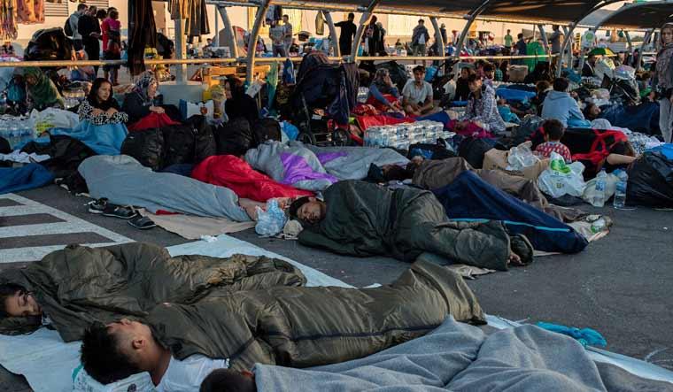 Greece-migrants-sleeping-Moria-camp-fire-Reuters