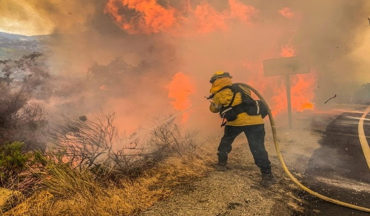 Firefighters trying to extinguish a fire, in Alpene, California on September 6 | Reuters