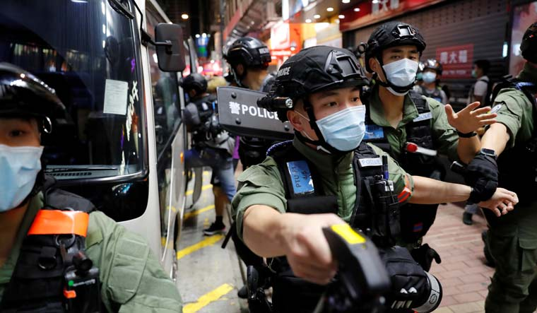 Hong Kong police arrest 90 at protests over election delay
