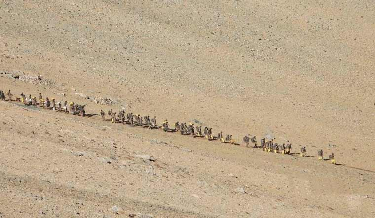 This photograph provided by the Indian Army, according to them, shows Chinese troops deinducting at Pangong Tso south region, in Ladakh along the India-China border on Feb. 15 | PTI