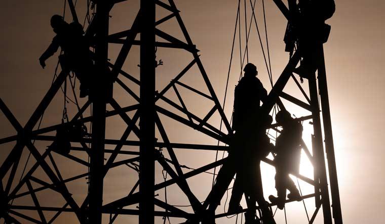 technicians-work-electric-power-line-reuters