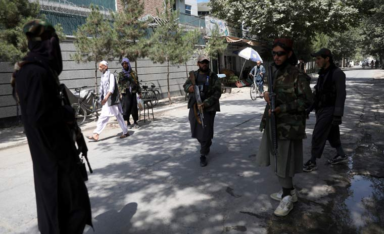 Taliban fighters stand guard at a checkpoint in the Wazir Akbar Khan neighborhood in the city of Kabul | AP