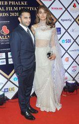 Adar Poonawalla with wife, Natasha/Photo Getty Images