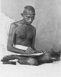 Gandhi writing a document at Birla House, Bombay