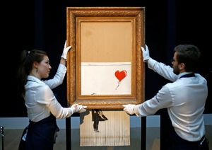 Photo Banksy's 'Girl With A Balloon', half shredded at Sotheby's/Reuters
