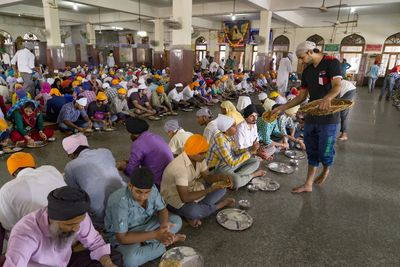 Food for all:  Pilgrims being  served food  at the Langhar, Golden Temple | Hari Mahidhar