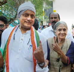 Shashi Tharoor with his mother after casting vote during the third phase of the 2019 Lok Sabha elections, at a polling station in Thiruvananthapuram | PTI