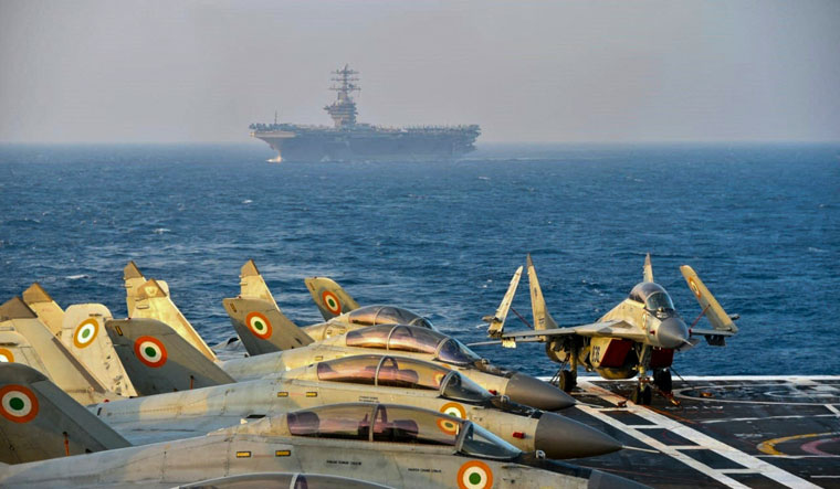 (FILE) This handout file photo taken and released by the Indian Navy on November 18, 2020 shows Indian army fighter jets on the deck on an aircraft carrier during the second phase of the Malabar naval exercise in the Arabian sea | AFP