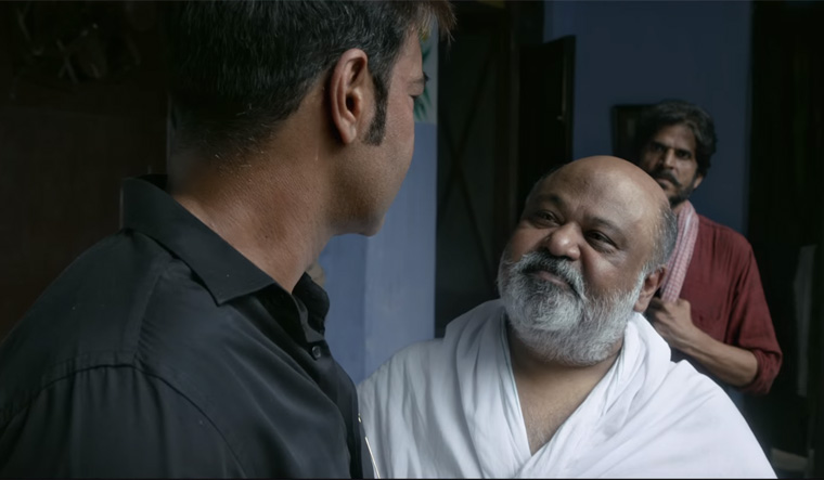 Saurabh Shukla (centre) in a still from the film