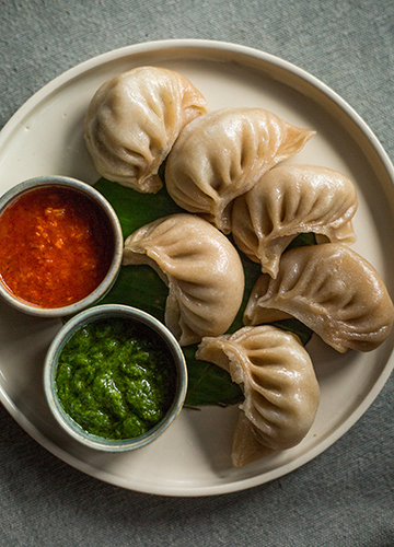 Spinach, spring onion and water chestnut momos at Fabcafe by Fabindia